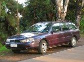 bordowy samochód marki ford mondeo