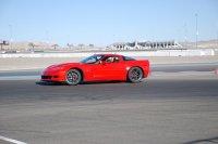 czerwony samochód marki corvette